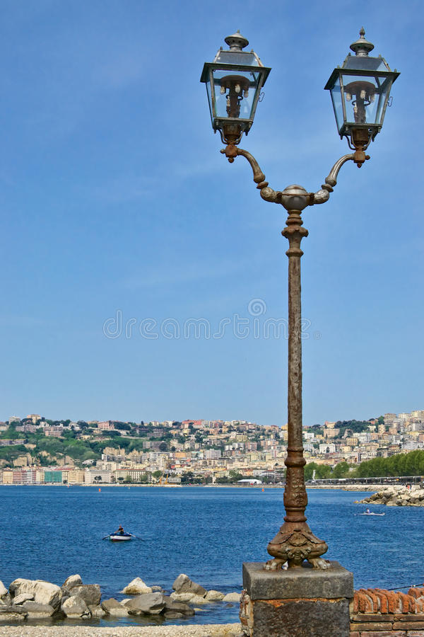 Lamp post on the sea royalty free stock image