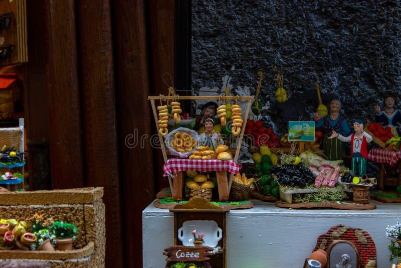 Naples, San Gregorio Armeno, bread shop in a Naepolitan Presepe.Typical Christmas decorations royalty free stock photos