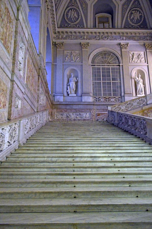 Naples` 16th century royal palace Monumental staircase. Monumental staircase at Naples palazzo reale or royal palace from 16th century when naples was under royalty free stock image