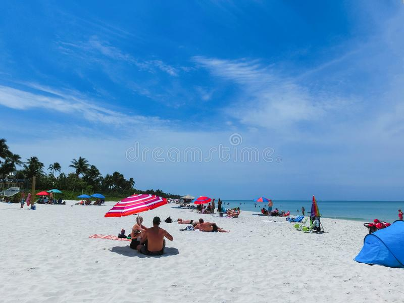 Naples, USA - May 8, 2018: Tourists enjoying the Vanderbilt beach in Naples, Florida. Naples is located on the Gulf Coast in southern Florida stock photo