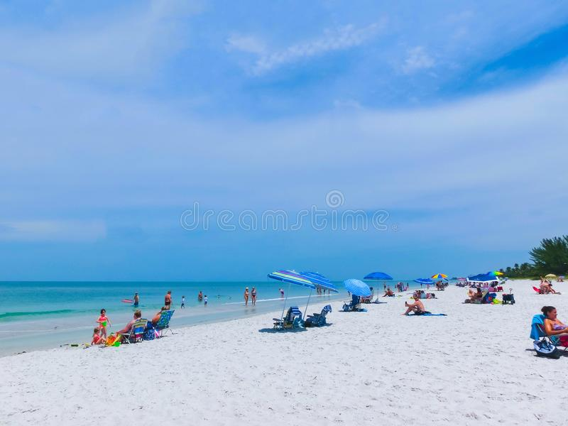 Naples, USA - May 8, 2018: Tourists enjoying the Vanderbilt beach in Naples, Florida. Naples is located on the Gulf Coast in southern Florida stock image