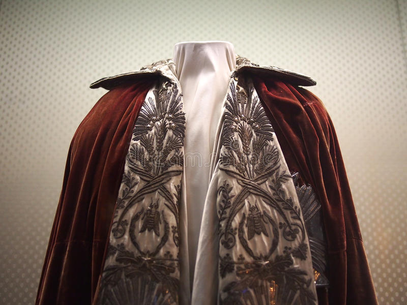 Napoleon coronation cape. Emperor Napoleon coronation cape. Decorated with wheat and bees. Delivered the day before the coronation of Napoleon in 1804, he was royalty free stock image