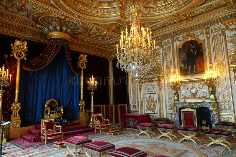 Trone room of Palace of Fontainebleau in France. In 1808 Napoleon decided to install his throne in the former bedroom of the Kings of France from Henry IV to royalty free stock photography