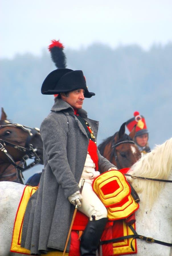 Napoleon riding a horse at historical reenactment stock photos