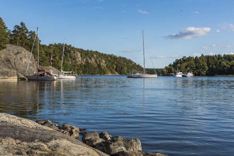 Napoleons bay natural harbor Stockholm archipelago. Sailingboats and motorboats anchored and moored in natural harbor at Napoleonviken English: Napoleons bay in stock photography