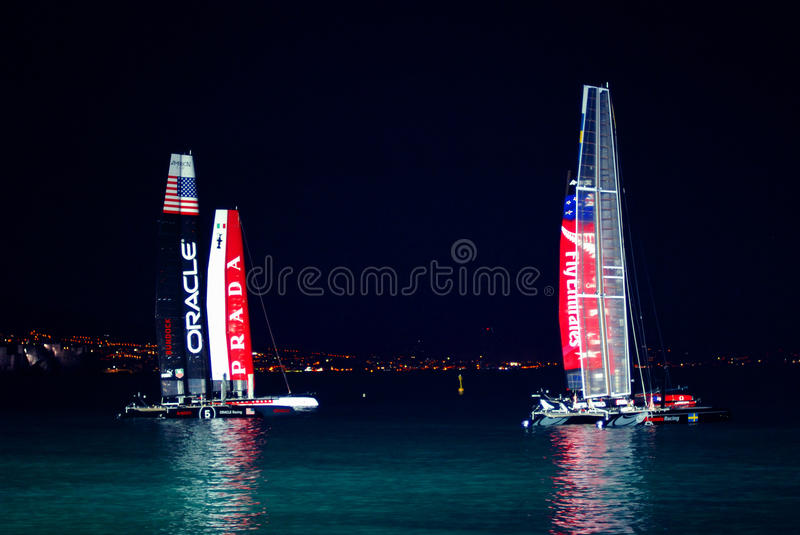 Napoli America's Cup 2012 at night. AC45 class sailboats in Naples for the America's Cup World Series (Napoli, april 11th - 15th royalty free stock photos