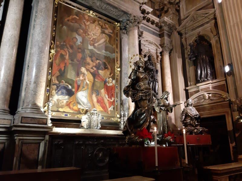 Napoli - Dipinto della Decollazione di San Gennaro sull`altare sinistro della Cappella del Tesoro. Naples, Campania, Italy - January 4, 2020: Baroque chapel of royalty free stock photos