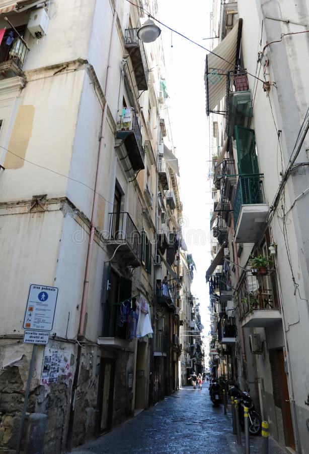 Napoli, Napoli, Italy - August 20, 2019: narrow street in the pl. Ace called Quartieri Spagnoli with high buildings royalty free stock photography