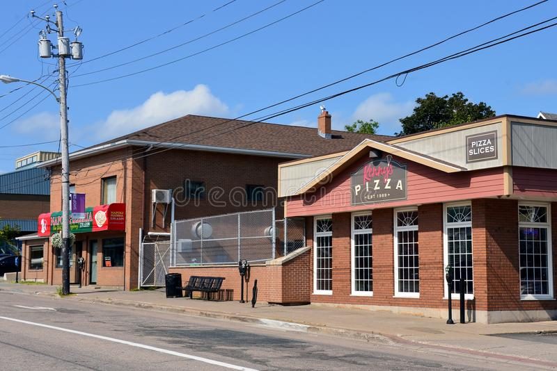 Napoli and Kenny`s Pizza compete in Sydney, NS. Sydney, Canada - August 4, 2017: Pizza shops Napoli, established in 1962, and Kenny's in 1989, are located stock photos