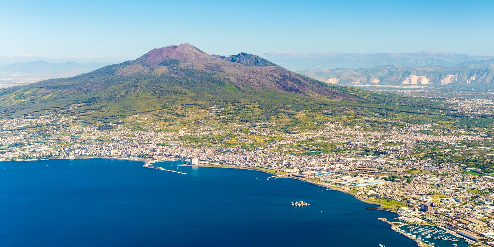 Napoli and mount Vesuvius in the background at sunrise in a summer day, Italy. Campania royalty free stock photos
