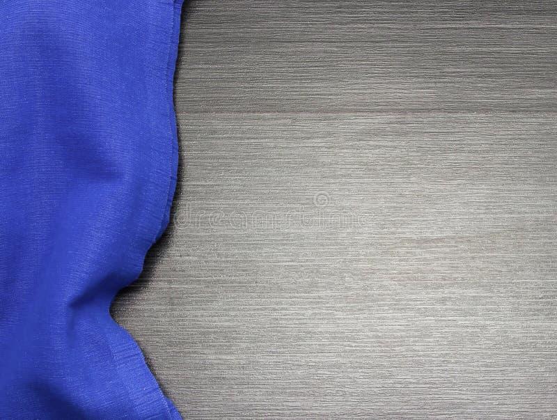Nappe bleue sur la table en bois pour le fond Texture de tissu Texture en bois Vue supérieure Copiez l'espace DES de calibre photographie stock