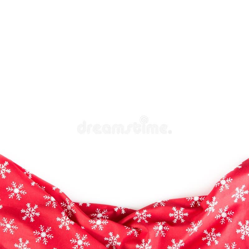 Nappe rouge de Cristmas avec des flocons de neige d'isolement sur le fond blanc - dessus de vue photographie stock libre de droits