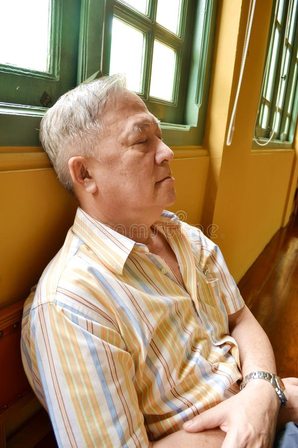 The napping of old man royalty free stock photo