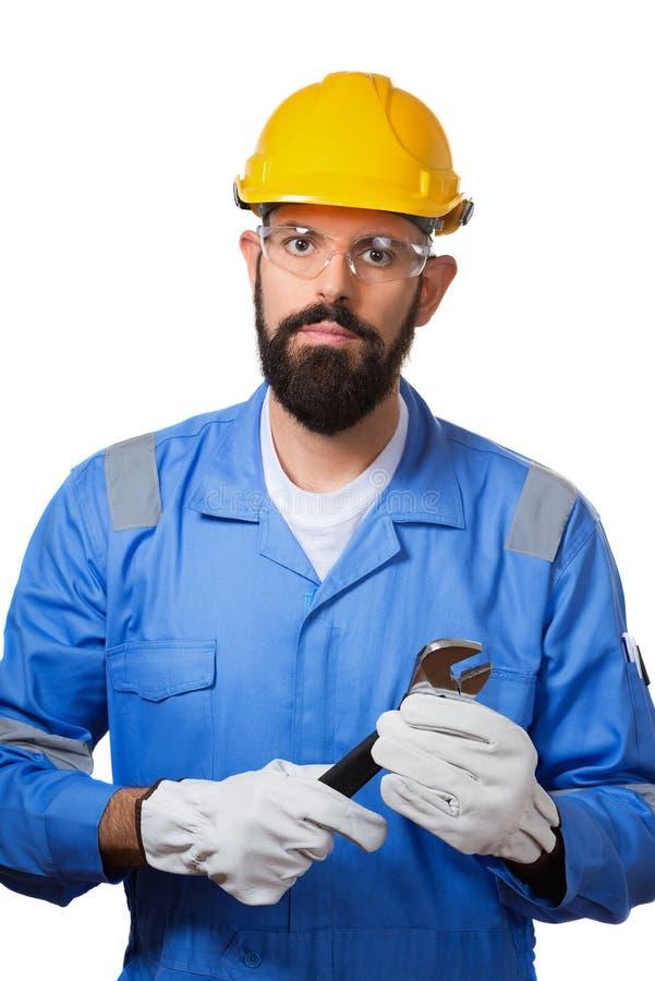 Naprawa, budowa, budynek, ludzie i utrzymania pojęcia mężczyzna, pracownik w żółtym hełmie, przejrzyści zbawczy szkła i zdjęcie royalty free
