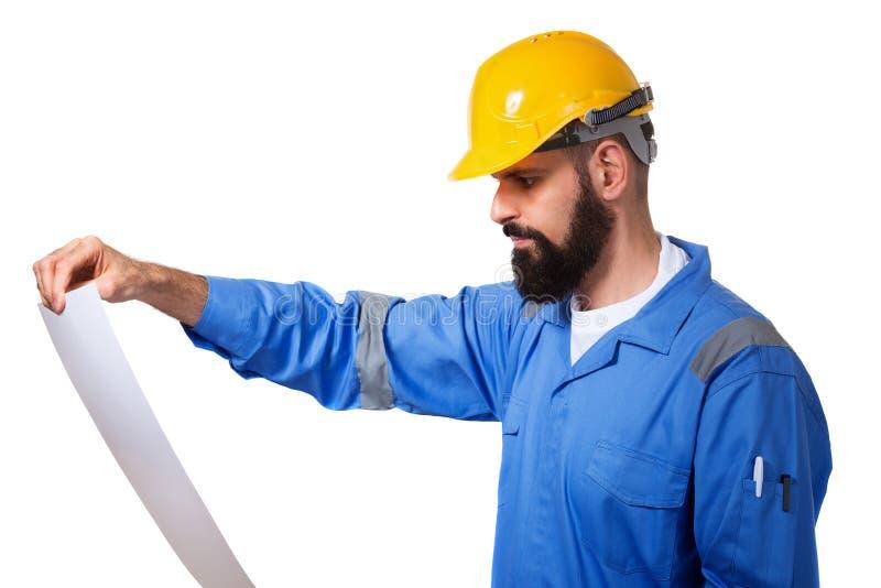 Naprawa, budowa, budynek, ludzie i utrzymania poj?cie, brodaty m?ski budowniczy lub r?czny pracownik z obrazu nakre?leniem - obrazy stock