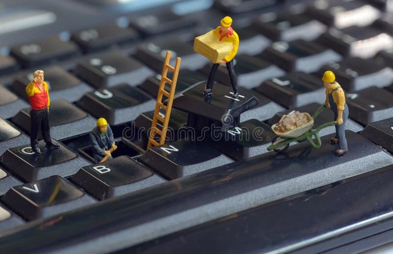 naprawianie klawiaturowi pracownicy fotografia royalty free