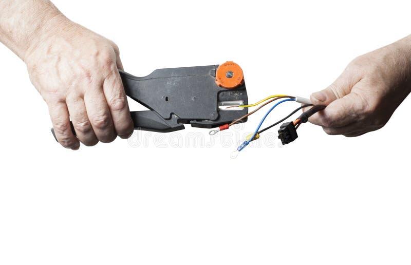 Naprawy, odświeżania, elektryczności i energii pojęcie, Elektryk struga daleko izolację od drutów odizolowywających na bielu fotografia stock
