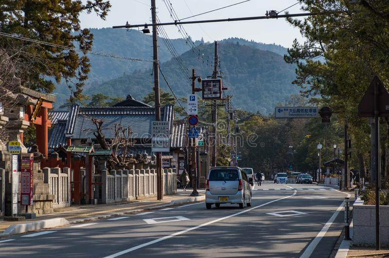 NARA, JAPAN - JAN 30, 2018: A car driving on street in Nara, showing the mounts and city royalty free stock images