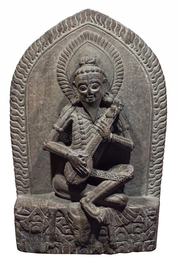 Narada - heavenly musician. Ancient Nepalese stone statuette. Narada - heavenly musician. Ancient Nepalese stone carving. Nepal, 15-16th century. In Hindu stock photos