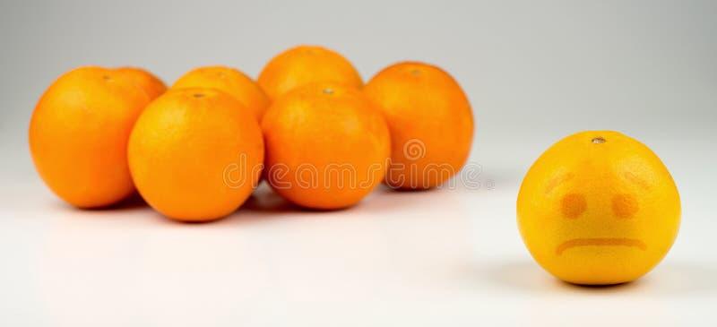 Naranja amarillenta segregada triste fotos de archivo