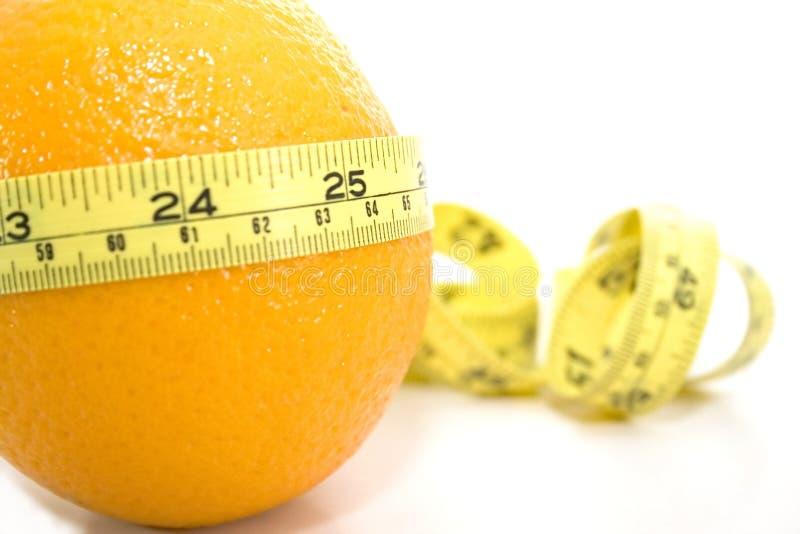 Naranja con el contador amarillo imagen de archivo