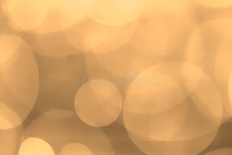 Naranja en colores pastel del fondo de Bokeh foto de archivo