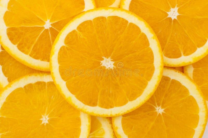 Naranja y fondo frescos de las rebanadas imagen de archivo