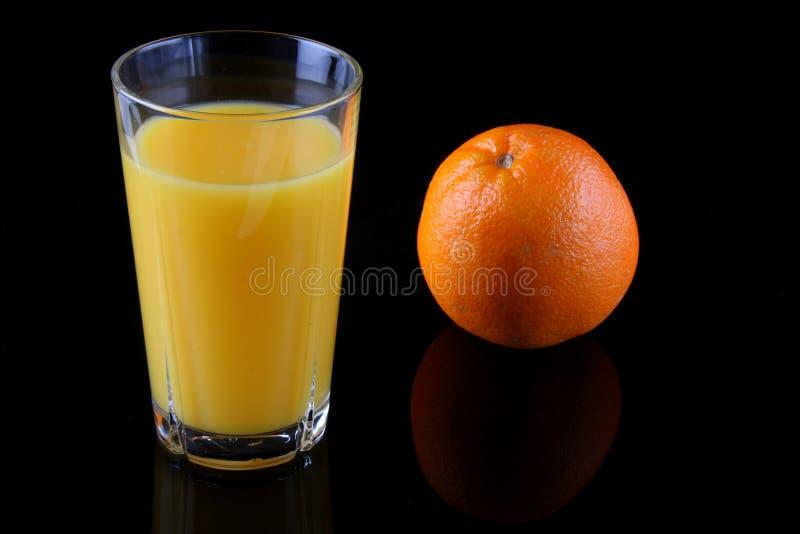Naranja y vidrio fotografía de archivo