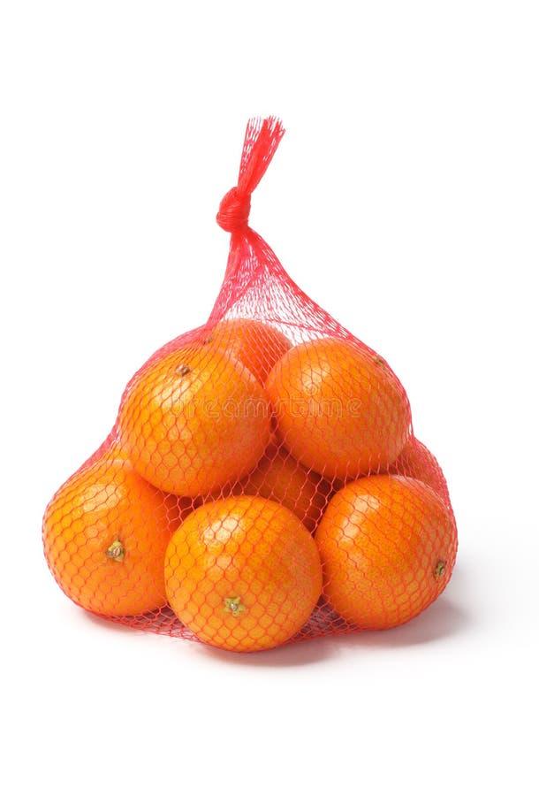 Naranjas en saco plástico del acoplamiento imagen de archivo libre de regalías