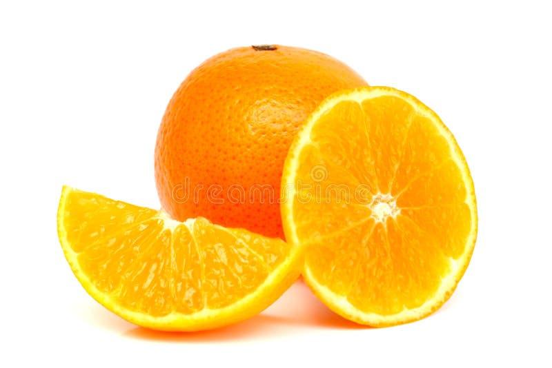 Naranjas y rebanadas anaranjadas fotografía de archivo