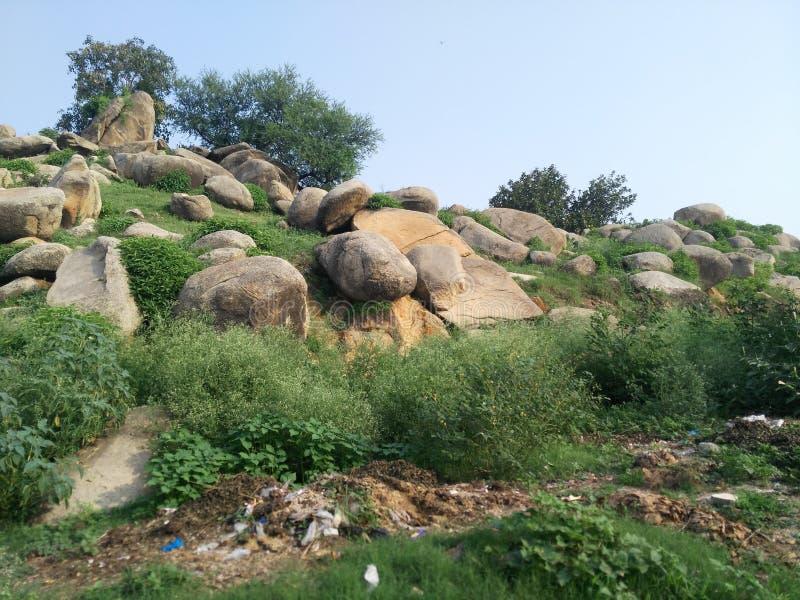 Naranji, Swabi, Pakistan. Nature, cradle, stones, green royalty free stock photos