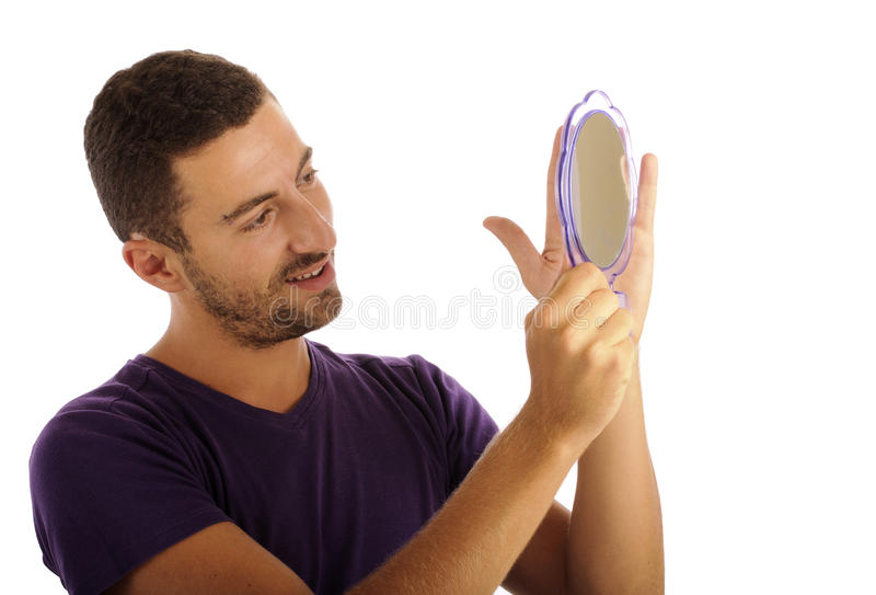 Narcissist regardant dans le miroir photo stock