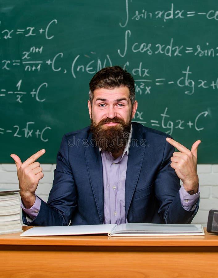 Narcissist selfish educator. Superior teacher in classroom. Arrogant school principal looking at camera. Self confident stock images