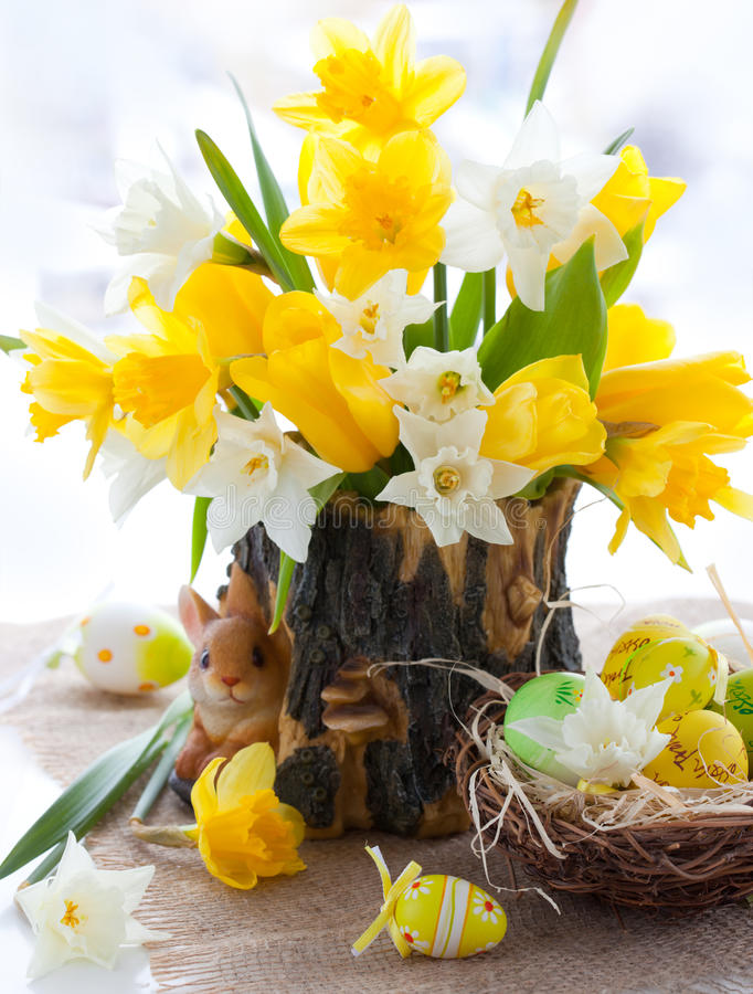 Narcissus and tulips for Easter. Bouquet of the fresh tulips , narcissus and easter eggs for Easter royalty free stock photos