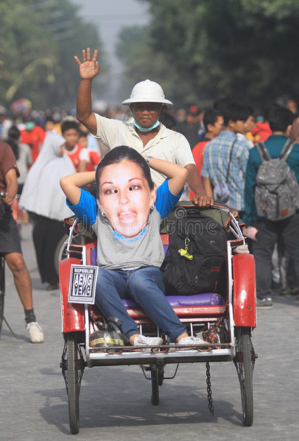 Narcotics action. Activist doing narcotics action using corby mask a queen of narcotics in solo, central java, indonesia stock photography