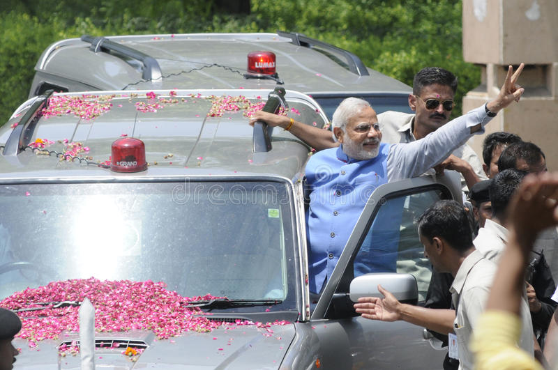 Narendra Modi in Delhi. NEW DELHI-MAY 17: Indian Prime Minister Narendra Modi waiving towards the crowd after wining the Indian National election on May 17, 2014 royalty free stock photo