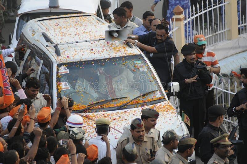 Narendra Modi in Varanasi. VARANASI - MAY 8: Commandos clinging onto Prime Minister Narendra Modi's car during a roadshow on May 8, 2014 in Varanasi , India royalty free stock photo