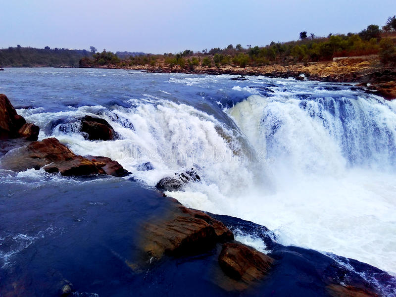 Narmada river waterfall, jabalpur india stock images