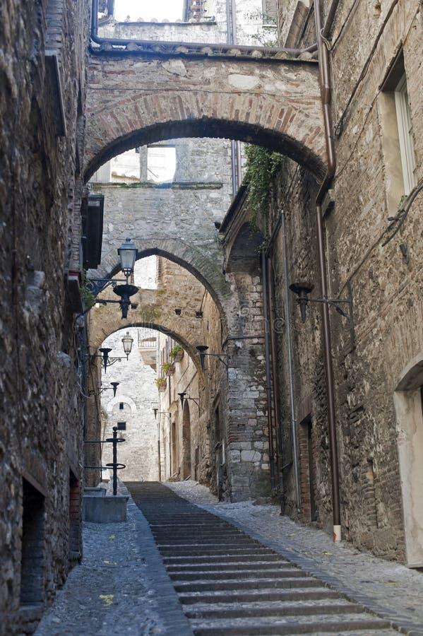 Narni (Terni, Umbria, Italy) - Old street. With arches stock photos