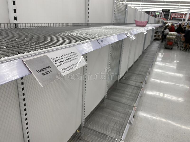 Empt shelves of toilet paper from the panic shopping. Narre Warren, Victoria Australia - March 6th 2020 -Empty toilet paper shelves in a supermarket caused by royalty free stock photo