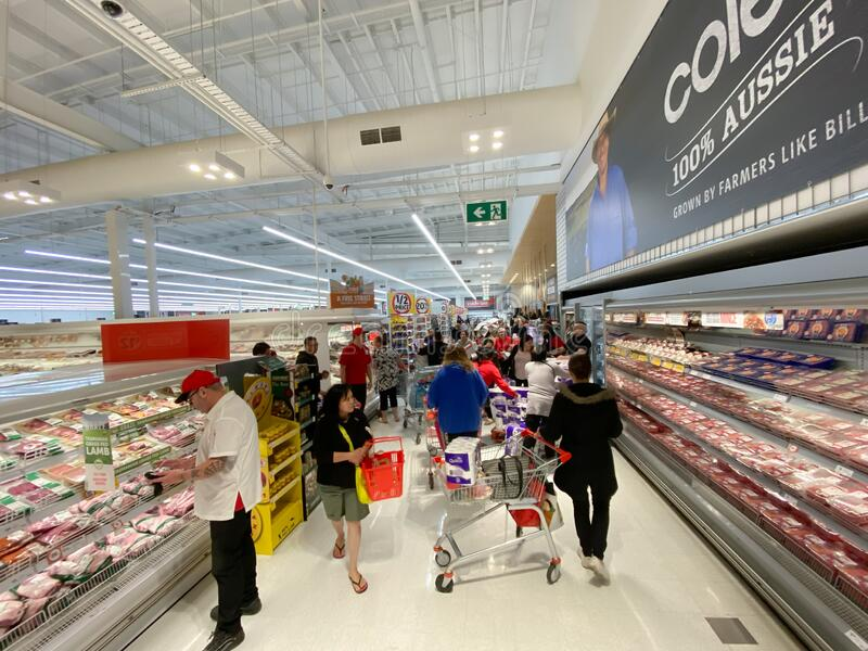 Shoppers panic buying toilet paper. Narre Warren, Victoria Australia - March 6th 2020 - Panicking customers in a supermarket buying toilet paper during the royalty free stock image