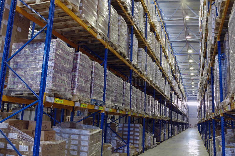 Narrow aisle warehouse with pallet storage system. royalty free stock images