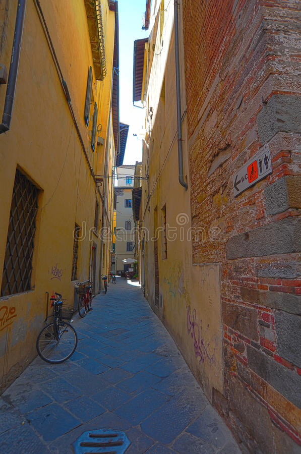 Narrow Alley. With Old Buildings In Italian City of Lucca stock images
