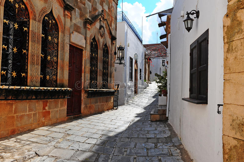 Narrow Alley. With Old Buildings In Typical Greek City stock photo