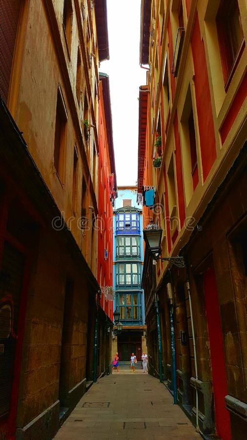 Narrow alley in Bilbao royalty free stock photos