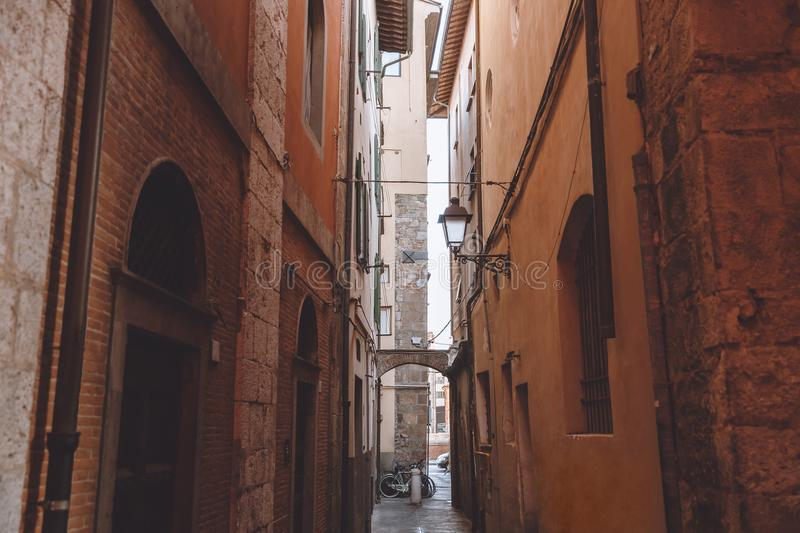 Narrow alley between buildings in old city,. Pisa, Italy stock images