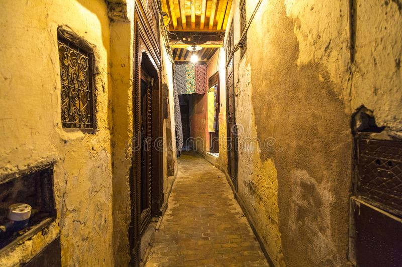 Narrow Alley in Fez, Morocco. A very narrow alley in the Fez medina in Morocco stock photo