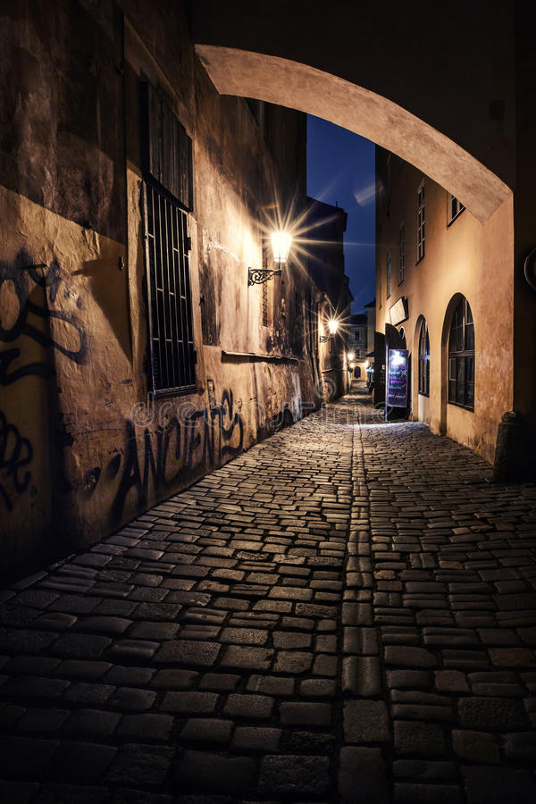 Narrow alley with lanterns in Prague at night. Mysterious narrow alley with lanterns in Prague at night royalty free stock photos
