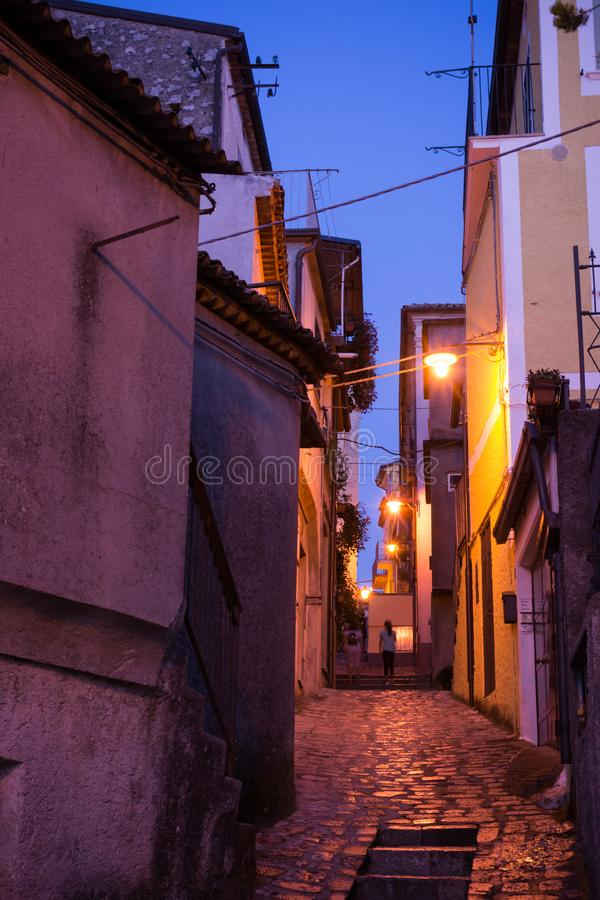 Narrow Alley Lightened at Blue Hour in the CIty of Rotonda, in the South of Italy. On Blur Background, alleys, basilicata, beautiful, clouds, sky, europe stock photo