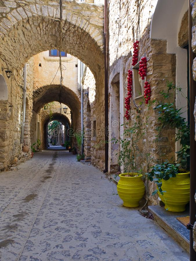 Narrow alley in medieval village. Of Mesta in Chios island, Greece. Traditional stone fortified village royalty free stock image